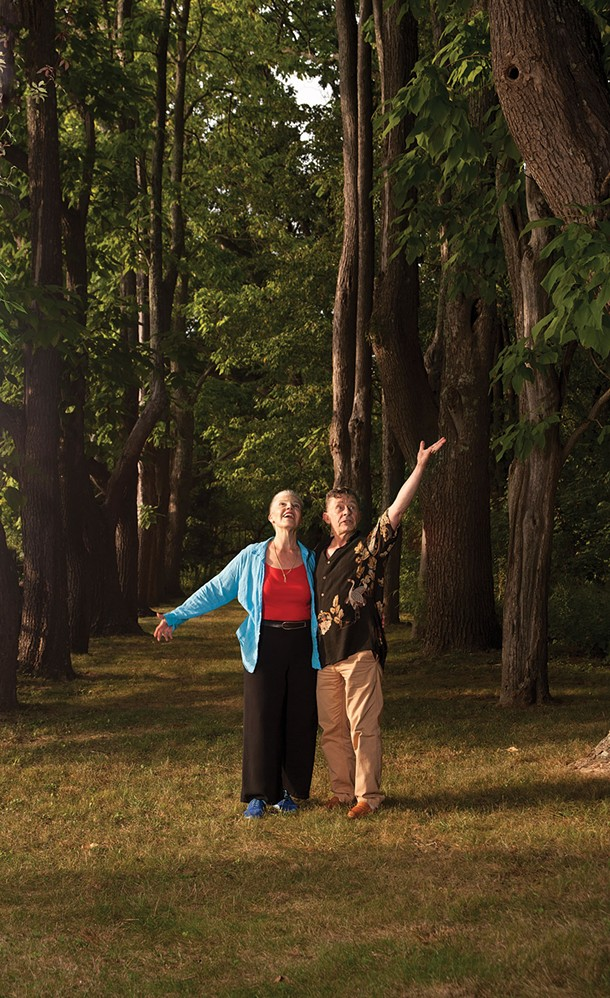 "Irene O'Garden and John Pielmeier amongst the trees of ""Windway."" - DEBORAH DEGRAFFENREID"