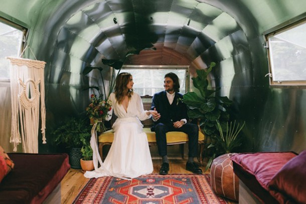 Bride and groom inside the Airstream. Photo by Quyn Duong for Rose & Dale.