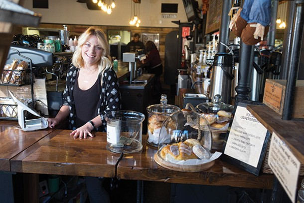 Owner Erin Intonti behind the bar at Underground Coffee & Ales in Highland. Underground is minutes away from the Walkway Over the Hudson and the Hudson Valley Rail Trail, which bring streams of cyclists to the spot in warmer weather. - PHOTOS BY ROY GUMPEL