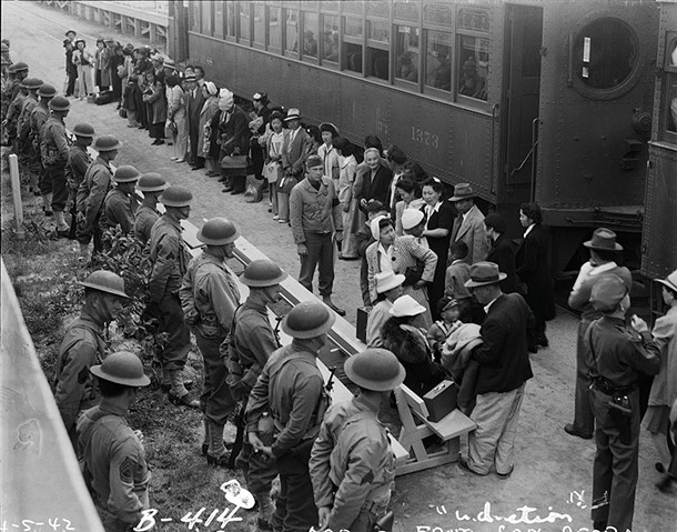 Japanese-Americans arrive under guard at the Santa Anita Assembly Center, April 5, 1942. - CLEM ALBERS