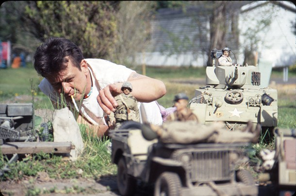 Mark Hogancamp staging figures for his alternative world Marwencol. Jeff Malmberg's 2010 documentary about Hogancamp, Marwencol, screens at Upstate Films in Woodstock on March 18.