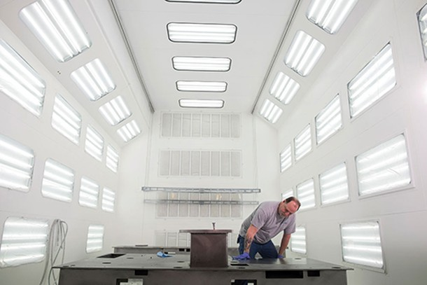 A technician at MPI Systems in Poughkeepsie prepares the painting room for the next batch of equipment. - ROY GUMPEL