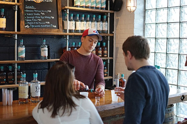 Mark Pisanelli tending bar at Denning's Point Distillery - JOHN GARAY