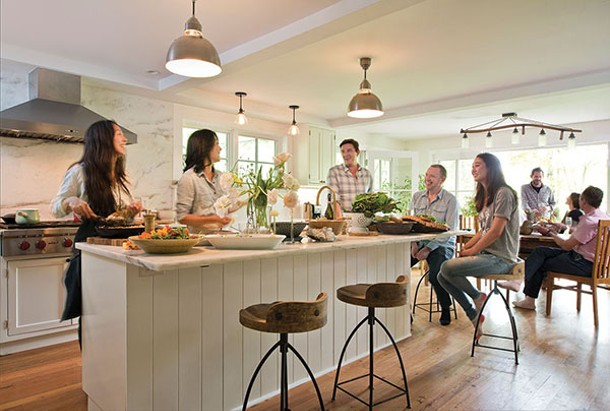 """Betty Choi, chef Doris Choi, Niall Grant, Craig Leonard (from left to right) in the kitchen. (Daughter Maia, seated with them at the island, and their guests will soon enjoy the lunch being prepared.) The Choi sisters have always had strong ties to food and family. Their journey—both to Woodstock and to a better understanding of nutrition—has changed all of their lives. """"Our awareness of food and our relationship to it is now a daily focal point in the way we live,"""" says Leonard. - DEBORAH DEGRAFFENREID"""