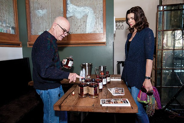 Ralph Erenzo pours Tuthilltown Whiskey for realtor Abby Royce. - RICHARD A. SMITH