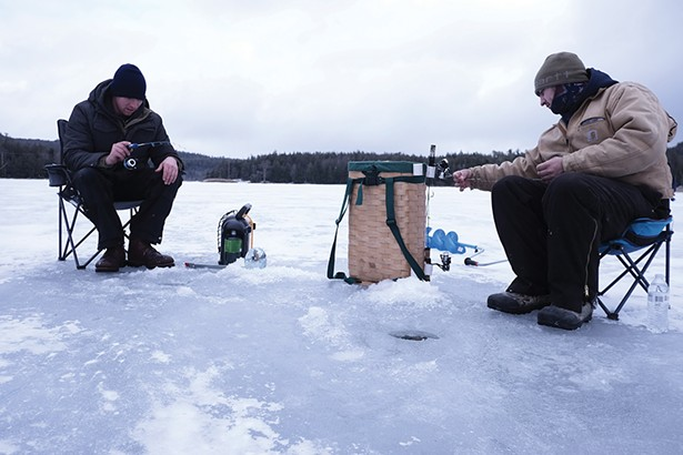 Kingston natives Brandon (left; he declined to give his last name) and Anthony Jansen fishing on North Lake, where the ice was seven inches thick. They'd been out since 4:30 in the morning, drilling holes and dropping lines as they moved down the shoreline. The two started fishing - together five years ago, after Anthony began dating Brandon's sister. - PHOTO BY ROY GUMPEL