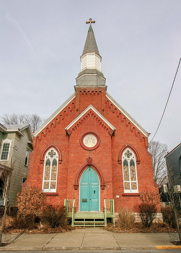 Jonah Bokaer's church turned live-work-event space sits on a quiet Hudson side street. The former St. Matthew's Lutheran church was de-sanctified in 2011 and then bought and rezoned as a house by the previous owners. Even though it was adapted for residential living, the 1869 brick Gothic Revival style building retains - the well-preserved original architectural embellishments, giving it an otherworldly feeling. - PHOTO BY SETH DAVIS