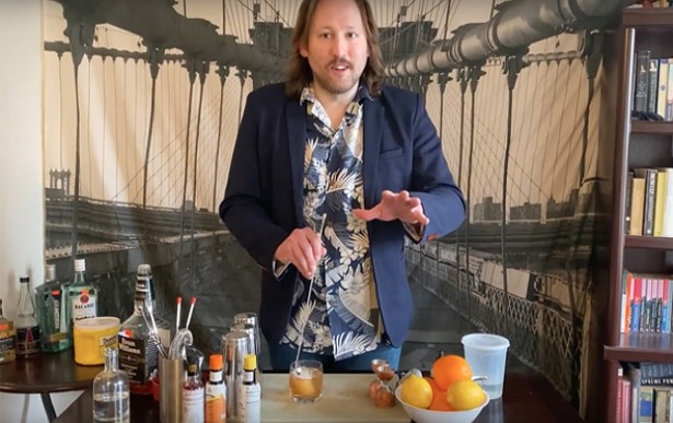 """Edward Gibbons-Brown mixing up booze and humor on the set of """"Cocktails for the Quarantine."""""""