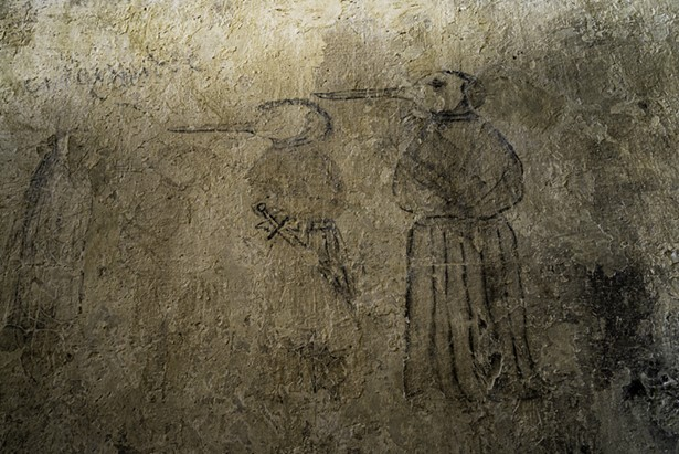 Wall drawing of a plague doctor.