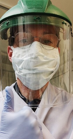 Mark A. Flower, director of Flower Funeral Home in Yonkers wears personal protective equipment while preparing the deceased for funerals. - MARK A. FLOWER
