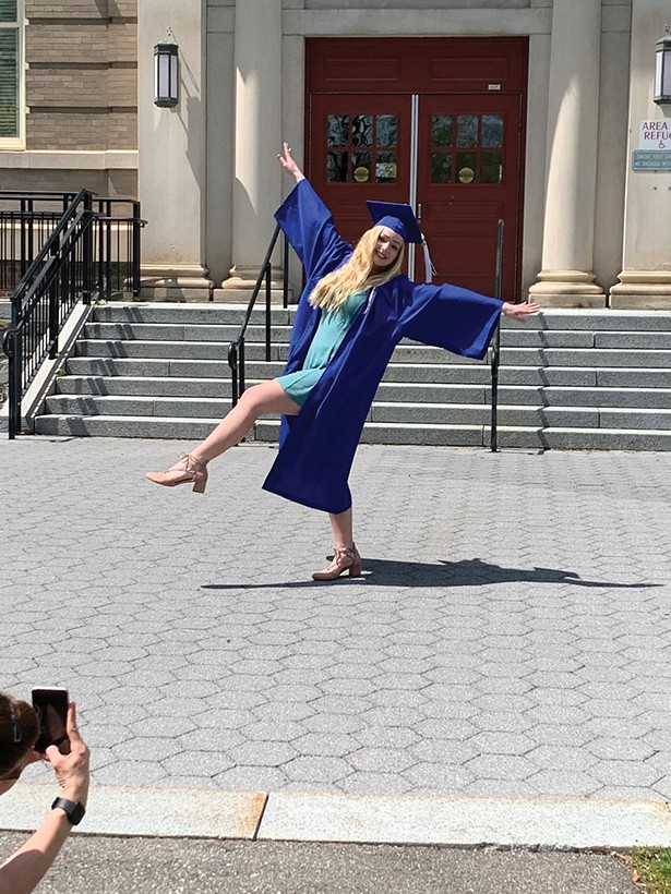 SUNY New Paltz graduate Skylar Galioto outside the Old Main Building on the New Paltz campus on Sunday, May 3.