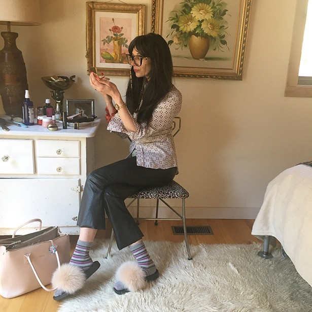 Clothing designer Stephanie Doucette gets - ready for work, which involves much time on Instagram. Doucette spends a lot of time juggling the school-based technology needs of her three children.