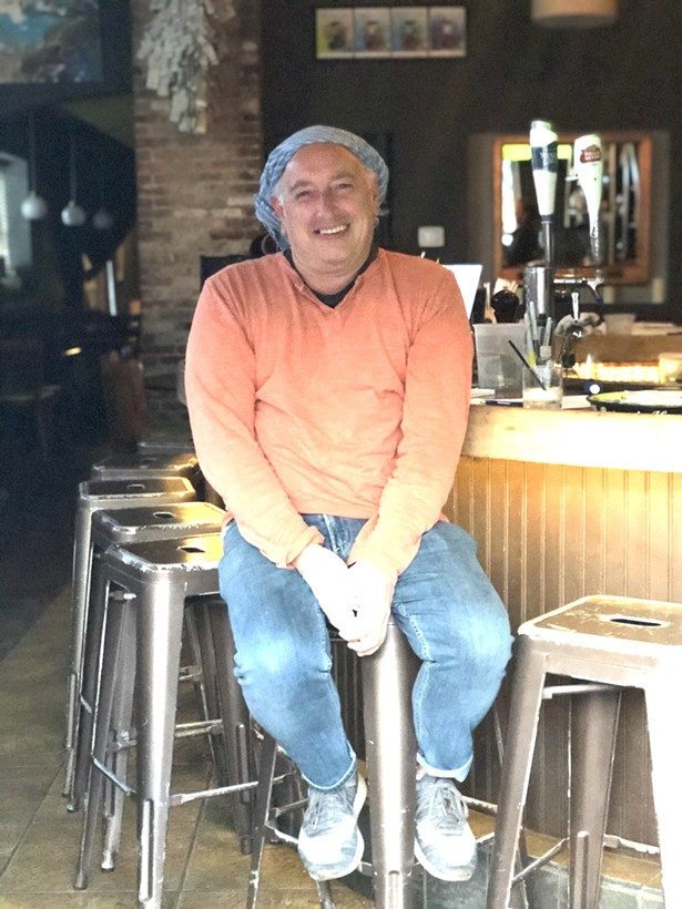 """Scott Eckert, manager of """"Changes"""" a men's clothing store. Scott is now helping out the owners at Gigi Trattoria - AMY WU"""