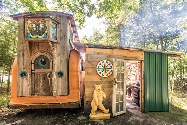 Quick is crafting a separate guest quarters in the style of a European Romani vardo wagon at his on-site wood working studio. Built on a hay wagon chassis, it will eventually have electricity and feature stained glass windows by Cassidy Ryan. - PHOTO BY WINONA BARTON-BALLENTINE