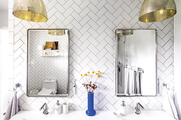 """Bottom: Schultz and Smyle completely reworked the master bathroom, adding tiles of contrasting colors and textures to the space. At the room's entrance, black and white Spanish style tiles are a nod to the home's previous residents, a Spanish couple. """"We don't want to forget the people who lived here before us,"""" says Schultz. """"They were together for such a long time."""" - PHOTO BY WINONA BARTON-BALLENTINE"""
