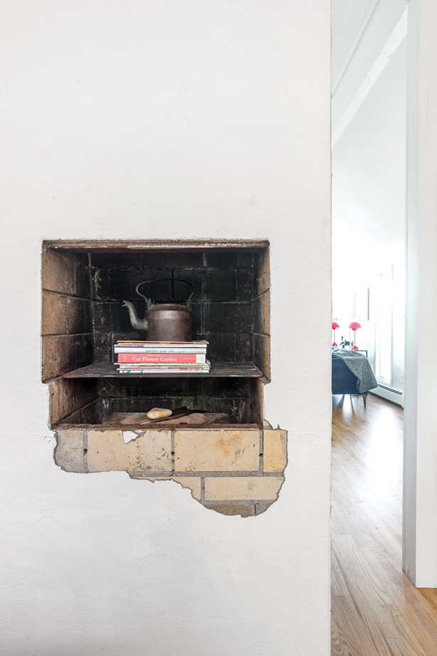"""The couple preserved a cut-out at the backside of the fireplace facing the kitchen. In their home, and now also with the front window of their newly opened Rhinebeck office/co-working space, the Beck, they love to create """"beautiful vignettes."""" """"We hope to find ways to creatively display the work of local artisans and makers,"""" says Schultz. """"The Beck is our love letter to the Hudson Valley,"""" adds Smyle. """" A thank you for the boundless talent and beauty it has to offer."""" - PHOTO BY WINONA BARTON-BALLENTINE"""