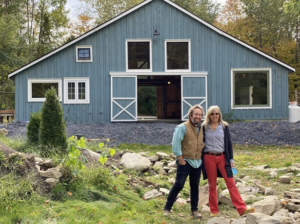 Lindsey and FireDean in front of the Dutchess County barn that serves as their shared creative space