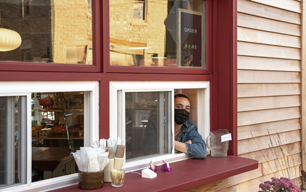 Co-owner Anna Morris at Kitty's takeout window. - SABRINA EBERHARD