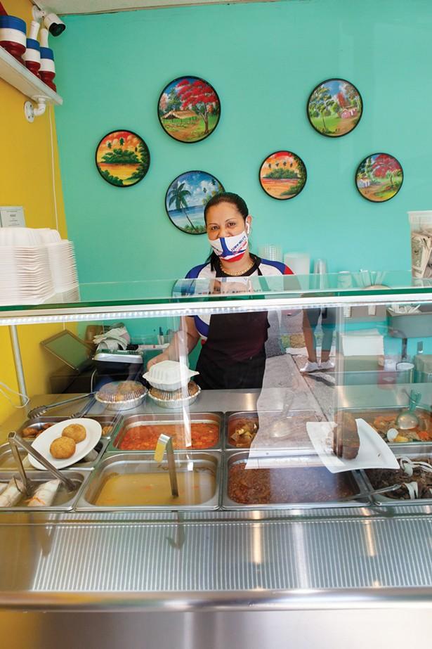 Ramona Malena serves up authentic Dominican fare like pork mofongo at New Nelly's restaurant on Main Street.