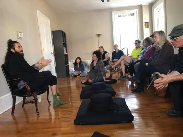 Luis Mojica teaches a class on holistic addiction recovery to certified recovery peer advocates and volunteers at Samadhi Recovery Community Outreach Center.