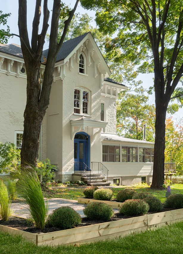 KingstonDesign Connecton's Maryline Damourgave the house's cream exterior a pop with the blue front door. Stone Ridge Landscaping beautified the yard, while Jen Dragon of Cross Contemporary Partners curated a mini sculpture garden. - ARIEL CAMILO PHOTOGRAPHY CO