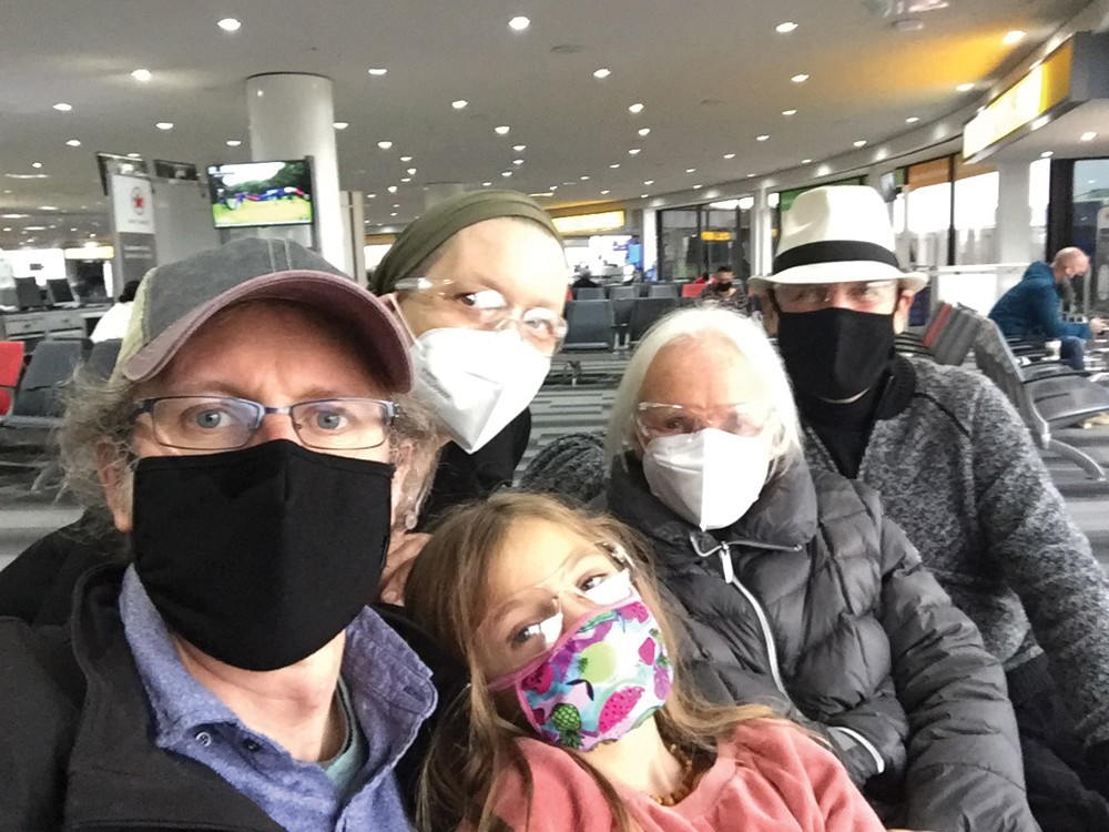 Jennifer May and family in the Newark Airport terminal, on their move to Canada. - PHOTO BY CHRIS METZE