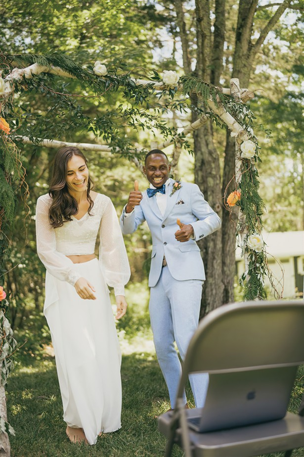 Alanna Badgley and Rudy Green receiving well wishes via Zoom at their frontyard wedding in Gardiner this summer. - PHOTO BY JOSHUA BROWN