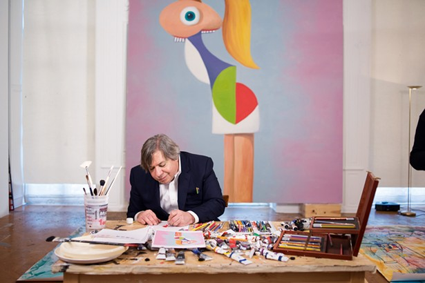 George Condo in his studio working on Fashion Model, his DIY art project for Open Studio. - PHOTO BY CASEY KELBAUGH