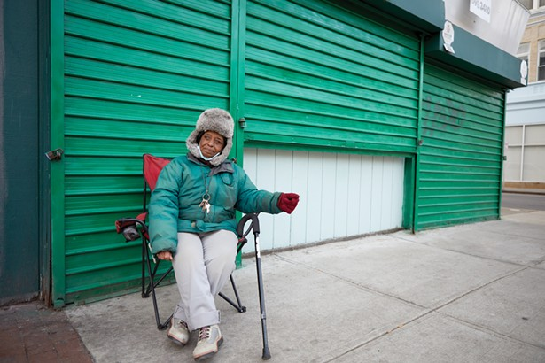 """Carmen is a self-described """"panhandler"""" who is so well known for sitting at the corner of Main and Catherine Streets that the mayor had a sign put up declaring the spot to be """"Carmen's Corner."""" - PHOTO BY DAVID MCINTYRE"""
