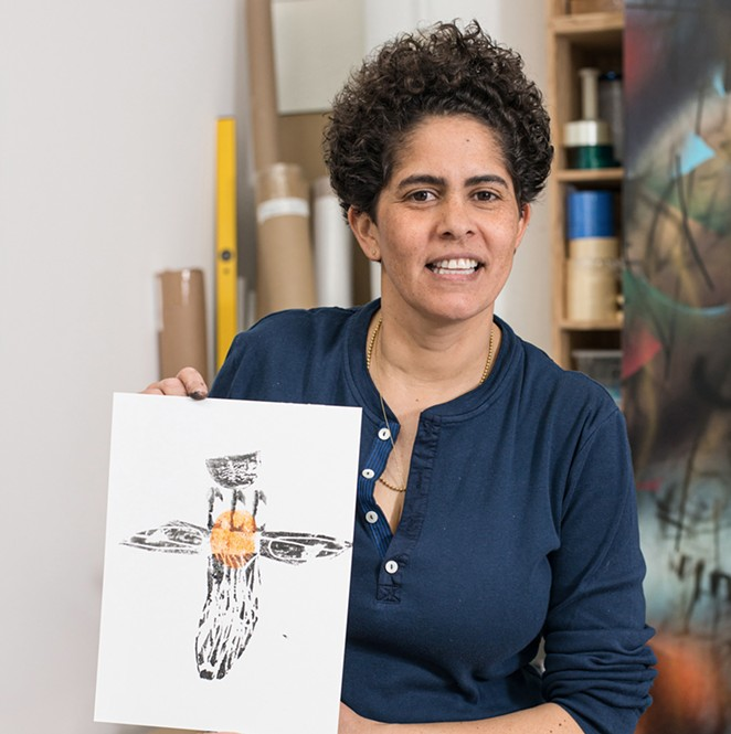 Julie Mehretu, with a print from a carved potato and sweet potato printing project. - PHOTO BY CASEY KELBAUGH