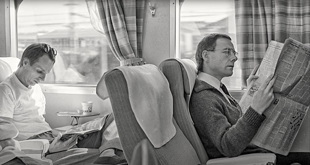 Adrian Belew and Robert Fripp of King Crimson on a train in Japan in 1981.