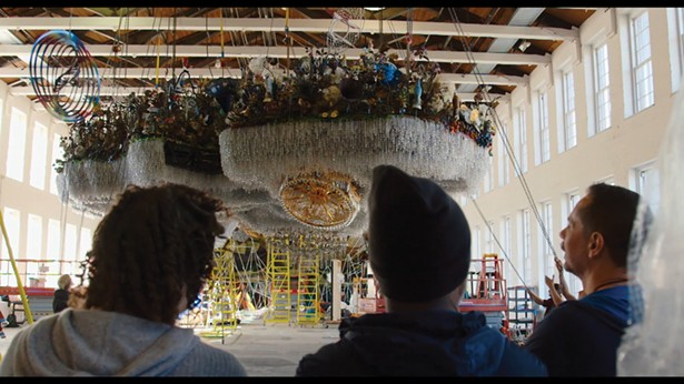 Nick Cave's monumental Crystal Cloudscape being - installed at MASS MoCA in 2016. - FILM STILLS COURTESY OF THE OFFICE ARTS