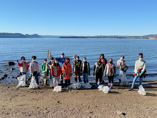 A Sweep volunteer group cleans up the shoreline in Ossining - PHOTO BY ROB LOWENTHAL