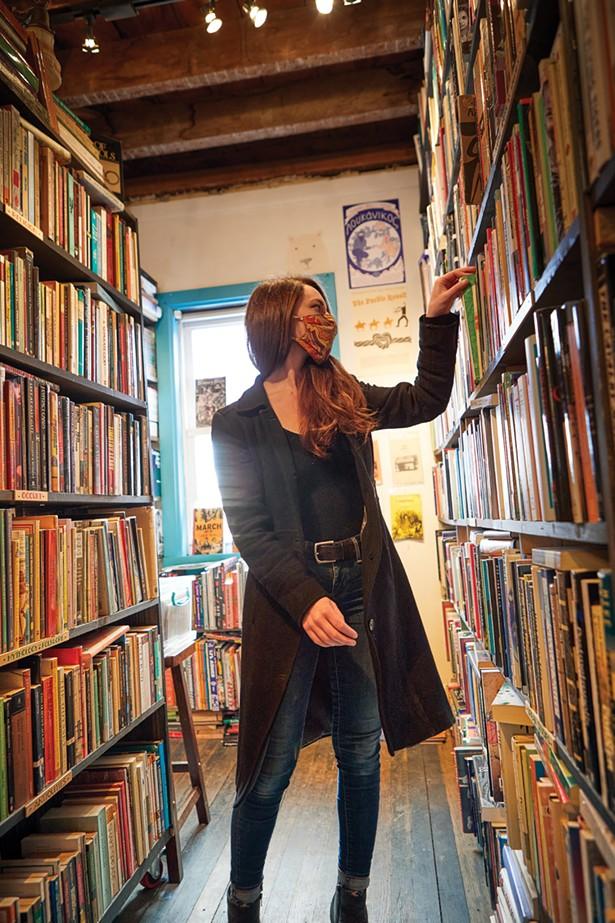 Bookseller Laura Bellizzi in the stacks at Binnacle Books. - DAVID MCINTYRE