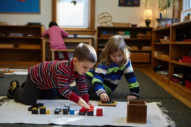 Early childhood students explore with the binomial cube, one of the foundational sensorial and math materials designed by Maria Montessori. - PHOTO BY ERIN WITKOWSKI