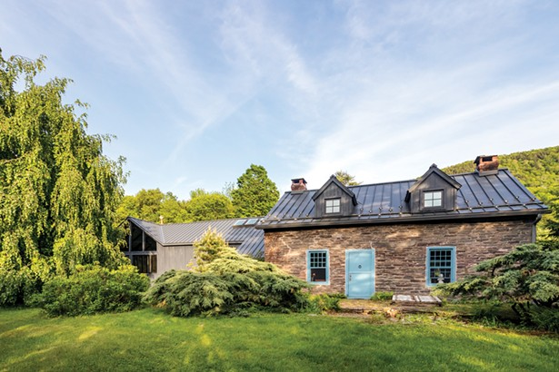 """Anne Hall's refurbished 18th-century farmhouse sits on 155 acres of land. To Hall the entire project—first the rehabilitation and total renovation of the home and then the establishing of the resident flower farm—may seem almost opposite in nature, but Hall sees commonalities. """"There's definitely a very elemental thread through all of this,"""" she explains. """"It's taking things down to their most basic processes, appreciating those and then finding new ways to work their basic elements."""" - WINONA BARTON-BALLENTINE"""