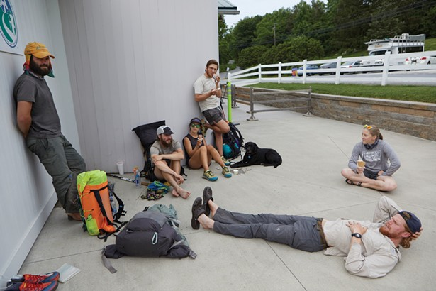 Appalachian Trail thru-hikers at Bellevale Farms Creamery. These are their hiking names from left to right: Bare Paw, Lebowski, Dash, No Name, Aurora (the dog), Anna, Zero. - DAVID MCINTYRE