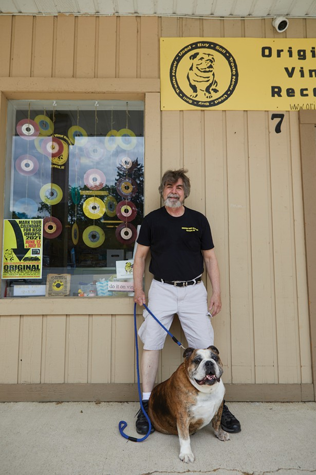 Original Vinyl Records specializes in new and used vinyl records, 45s, 78s, cassettes, 8-tracks, and music memorabilia. Co-owner Jim Eigo is pictured with Diesel, the store's mascot. - DAVID MCINTYRE
