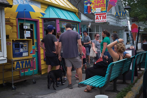 A bustling scene outside Taco Juan's on Tinker Street. - DAVID MCINTYRE