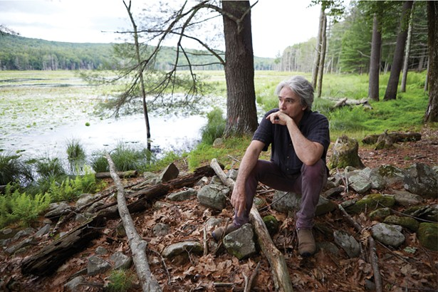 Musician and writer Tad Wise in his backyard. Like many longtime Woodstock residents, Wise is concerned that short-term rentals are turning neighborhoods into ghost towns. - DAVID MCINTYRE