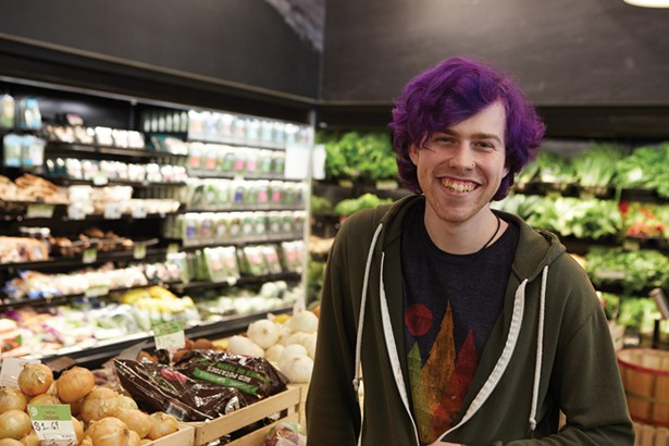 Duncan Dempsey in the produce section of Sunflower Natural Foods Market. - DAVID MCINTYRE