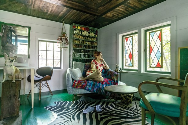 """Facci converted a tiny cottage at one corner of the - property into a studio where she runs Facci's Felted - Friends. She began needle felting animals as a hobby - in her Manhattan living room and in 2017 turned her - skill at it into a business. To recreate the cozy, feeling - of her former work space, she refinished the floors - and ceiling and loves to sit by the working fireplace - while she crafts. """"I designed the studio to feel like a - mini-living room,"""" she explains. """"I wanted a cozy, warm - feeling in here."""" - WINONA BARTON BALLENTINE"""