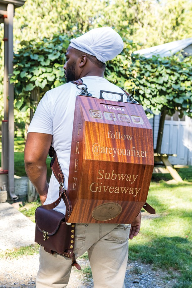 Jackson with the backpack he crafted for guerrilla marketing on the subway in New York City. His handcrafted raffle giveaways were a hit and he was gathering a growing following until the pandemic. He hopes to be back on the subway soon. - WINONA BARTON-BALLENTINE