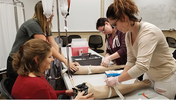 SUNY Sullivan Medical Assistant students practicing blood draws as part of a Basic Phlebotomy Lab course, taught by faculty member Grace Collaro.