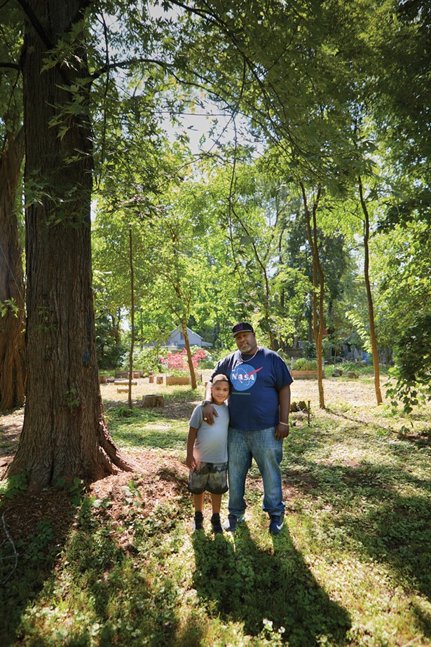 Harambee founder Tyrone Wilson with his son Jayden at the Pine Street African Burial Ground. - DAVID MCINTYRE