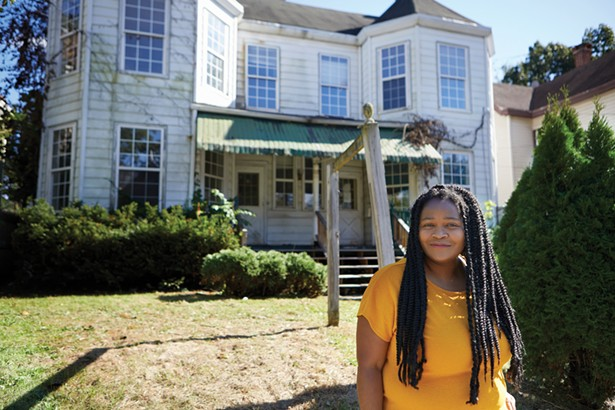 Rashida Tyler of the Real Kingston Tenants Union and Ulster County Coalition for Housing Justice in front of a house on Henry Street owned by the City of Kingston that has been vacant for three years. - DAVID MCINTYRE