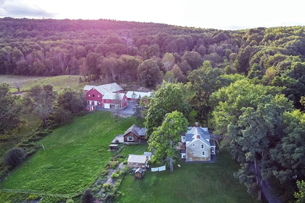 Founded in 1790, Lime Kiln Farm sits on over 400 acres of pasture and wooded hillside. The property includes two classic post-and-beam barn complexes, the original fieldstone farmhouse, and multiple outbuildings. There's also a pond, the family cemetery where first settler Thomas Houghtaling and his son are buried, and the original lime kiln. The farm is listed on the National Register for Historical Places in New York. - WINONA BARTON-BALLENTINE