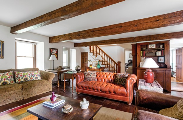 """The interior of the home is lined with the original wide plank wooden floors and ceiling beams. """"When we first arrive at a place, we consider how it originally was built,"""" says Voglino, who was born in Sardinia but grew up in Rome. """"We don't intend to knock things down. We want to make things functional and beautiful but we also want to save the original spirit of a place. That's been our mission in life."""" - WINONA BARTON-BALLENTINE"""