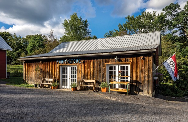 """Voglino and Zimmerman converted a wooden outbuilding into a farm store and cheese room. """"We have lamb, we have eggs, we have cheese, we have tomato sauce from our garden, and we have a baker who makes pies,"""" says Zimmerman. """"Also, Alessandro makes a very good cheesecake."""" - WINONA BARTON-BALLENTINE"""