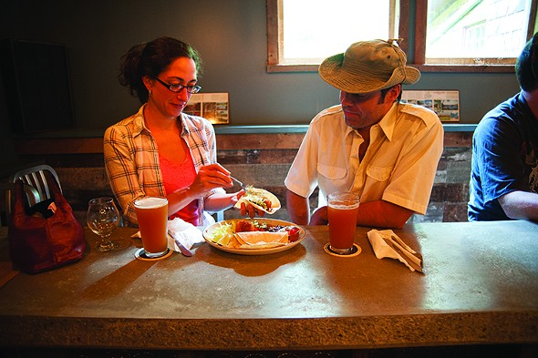 Adele Shulz and Jeremy Backofen eating at the bar. - ROY GUMPEL